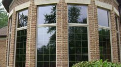 brick home with tinted windows